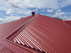 Red Colorbond Metal Roof with the sky in the background
